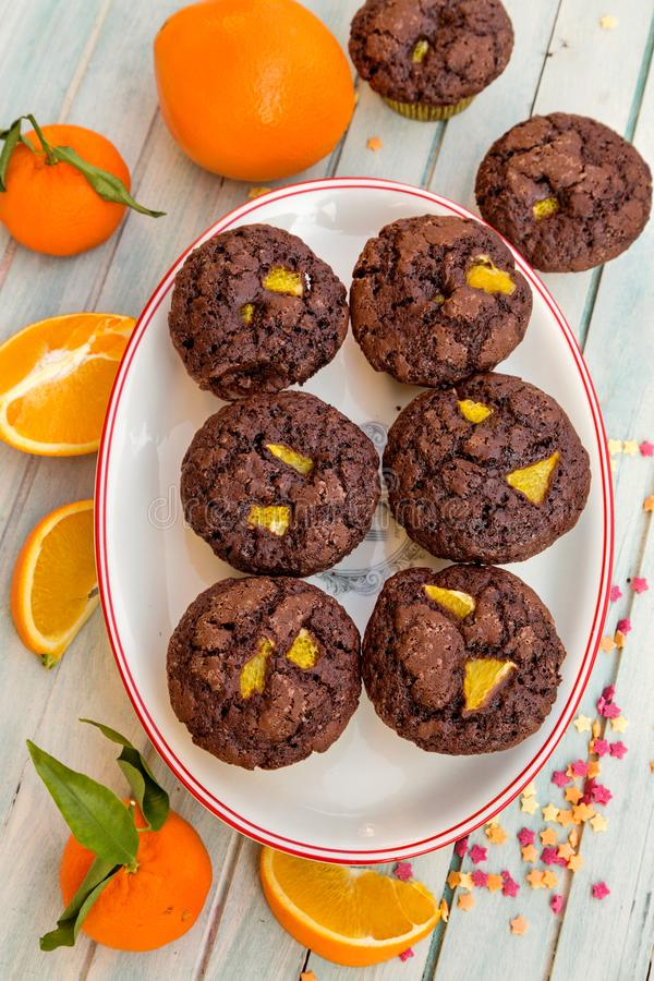 Muffins with chocolate and oranges stock photos