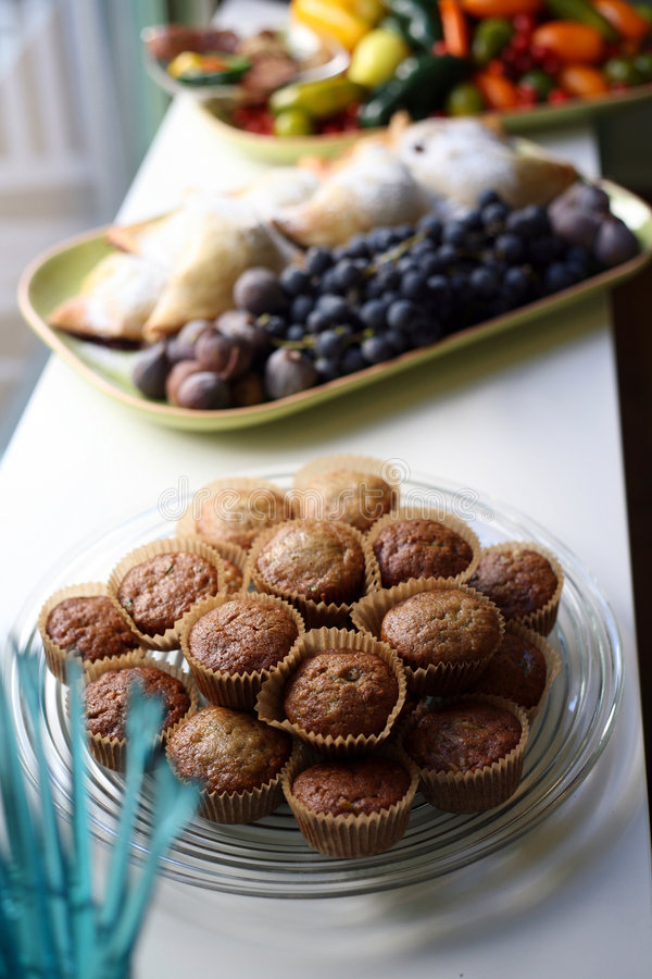 Muffins and fresh fruit stock photos