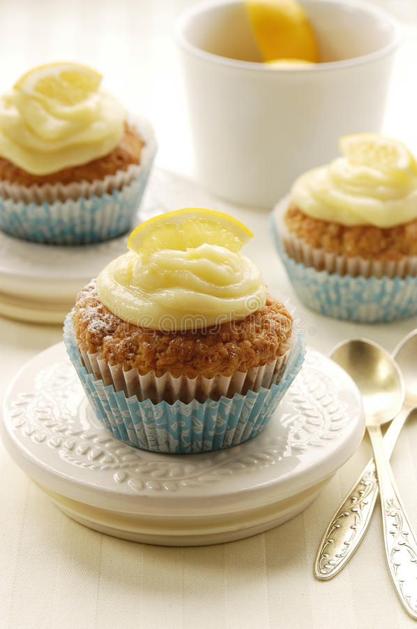 Muffins with lemon curd stock photography
