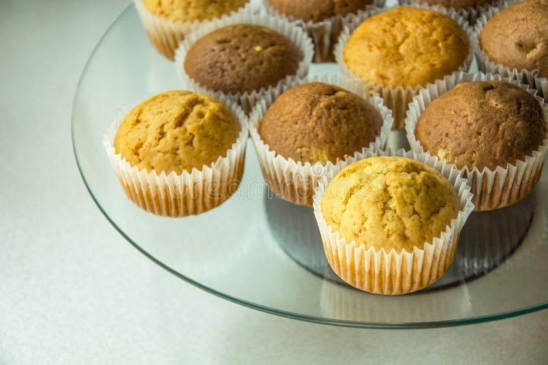 Muffins in molds on a glass plate royalty free stock photography