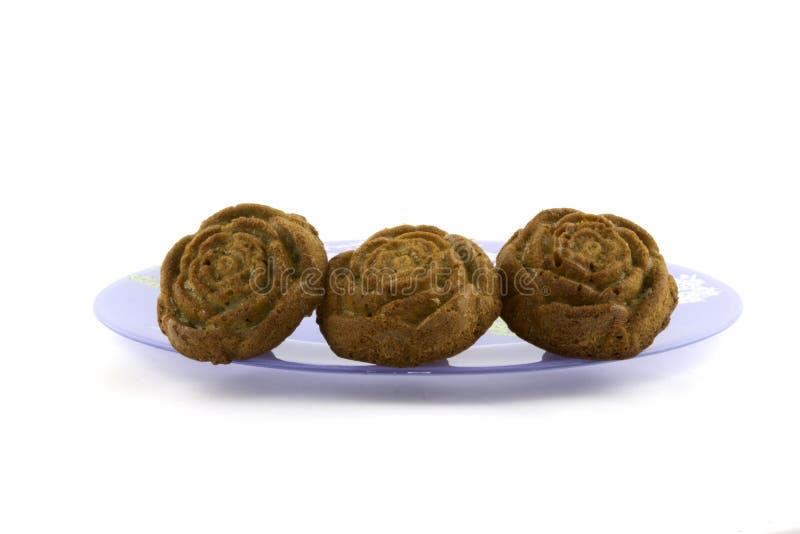 Muffins na białym backgraund obrazy stock