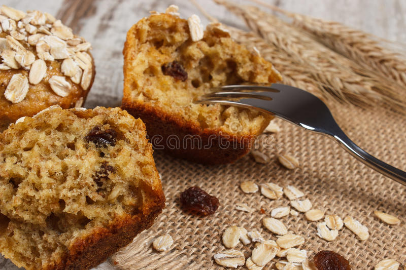 Muffins with oatmeal baked with wholemeal flour and ears of rye grain, delicious healthy dessert royalty free stock photos