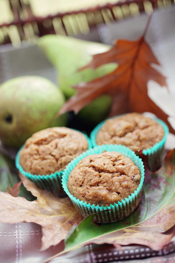 Muffins with pear royalty free stock photography
