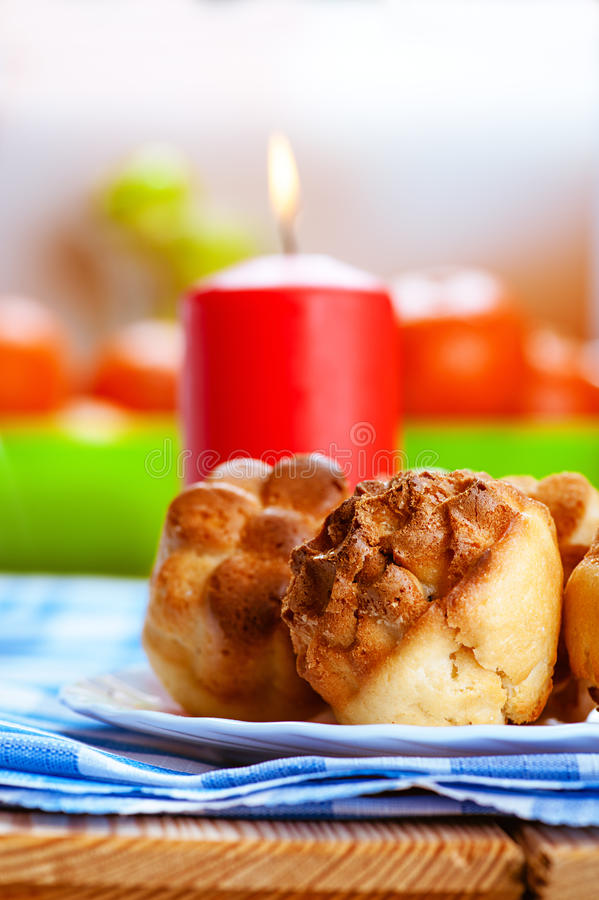 Muffins and red burning candle