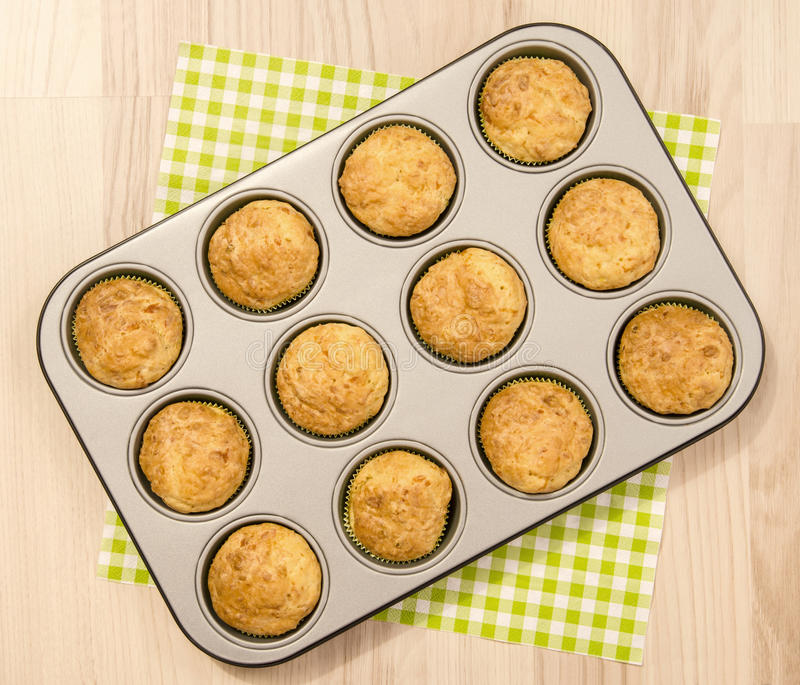 Muffins in a tray. Twelve muffins in a tin tray royalty free stock image