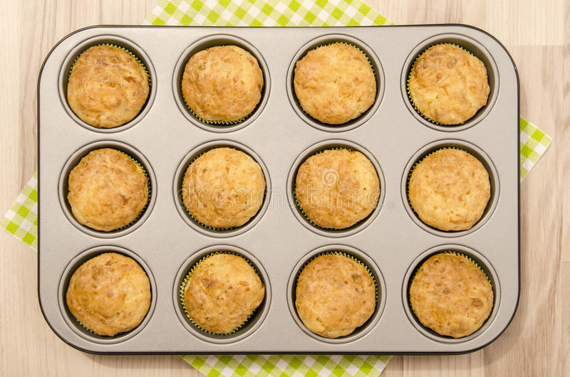 Muffins in a tray. Twelve muffins in a tin tray royalty free stock images