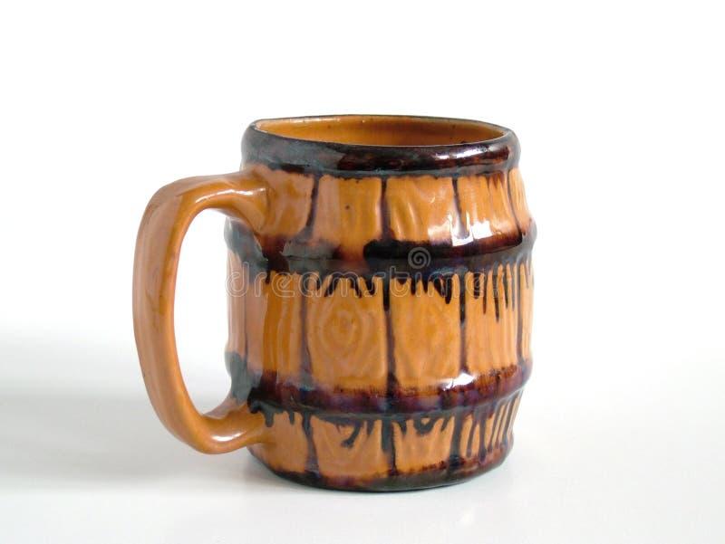 Mug. Isolated, handmade traditional clay mug royalty free stock images