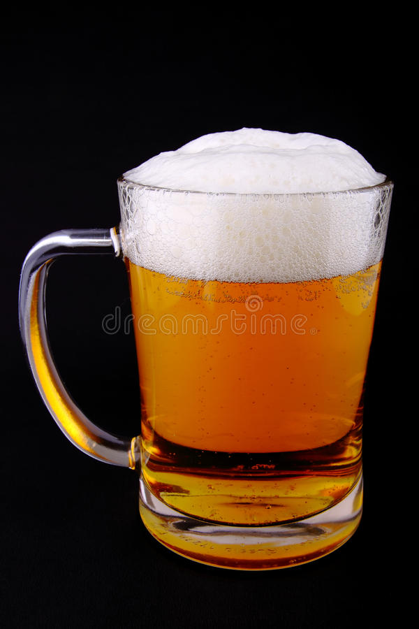 Mug of beer. Isolated beer mug on black background stock images