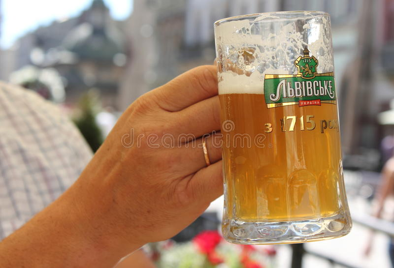 Mug of beer Lviv in Lviv. Lvivske - Ukrainian beer brand, produced Lviv brewery since 1715 currently - Open Joint Stock Company Lviv Brewery is a part of the royalty free stock images