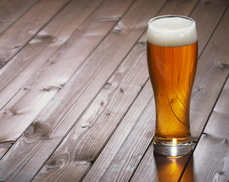Mug of beer. On wooden background royalty free stock photography