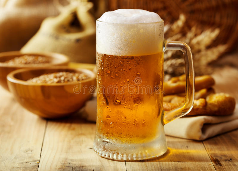 Mug of beer. On wooden table royalty free stock image