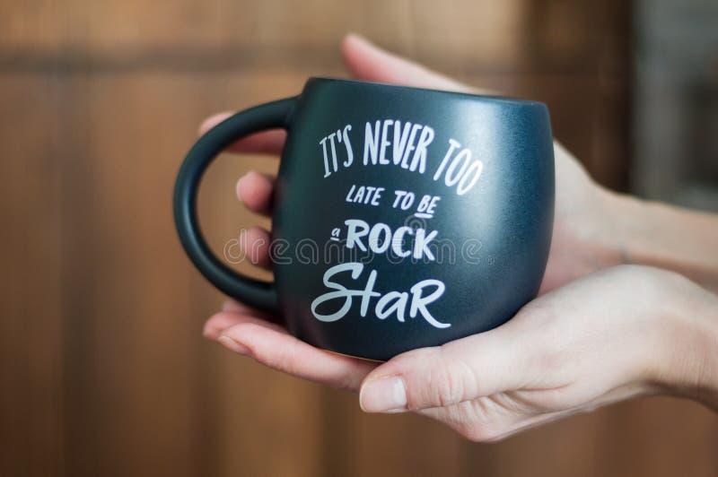 Mug, black mug, cup, big cup, in the hands stock photos