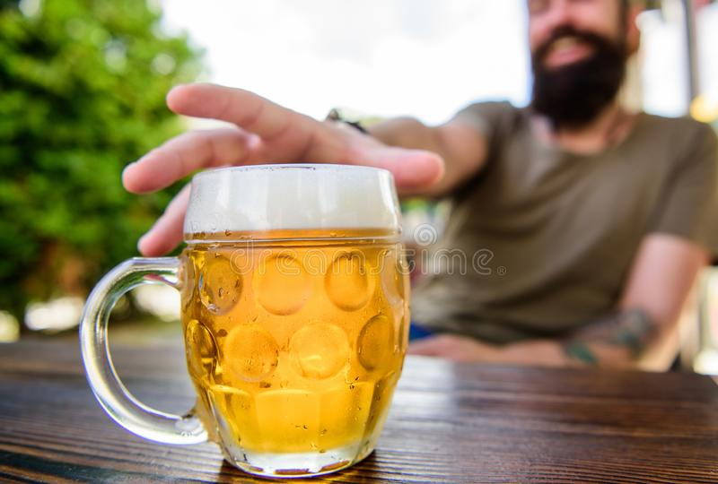 Mug cold fresh beer on table close up. Distinct beer culture. Man sit cafe terrace enjoying beer defocused. Alcohol and. Bar concept. Creative young brewer royalty free stock photography