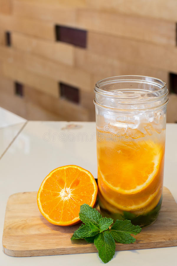 Mug delicious refreshing drink of orange fruit , infused water royalty free stock image