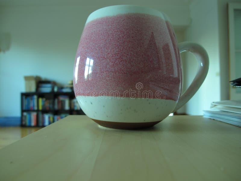 A Mug on a desk royalty free stock photography