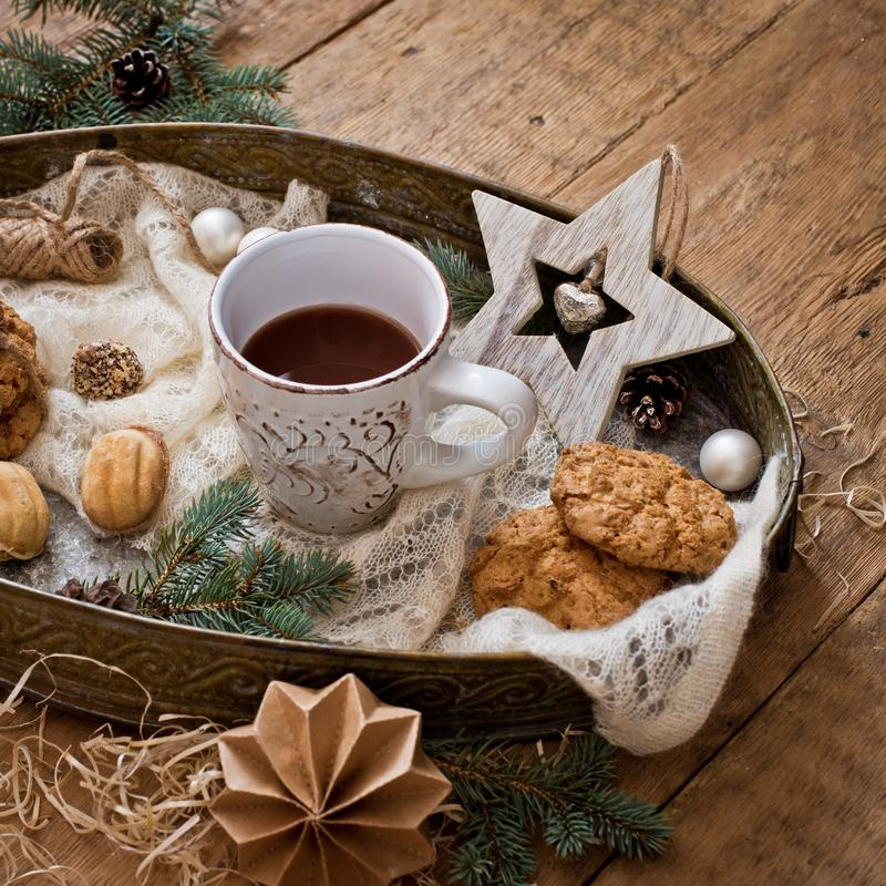 Mug with drink and cookies with Christmas decoration stock photography