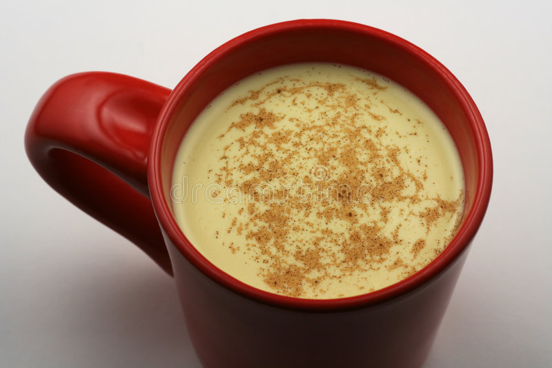 Mug of eggnog stock photography