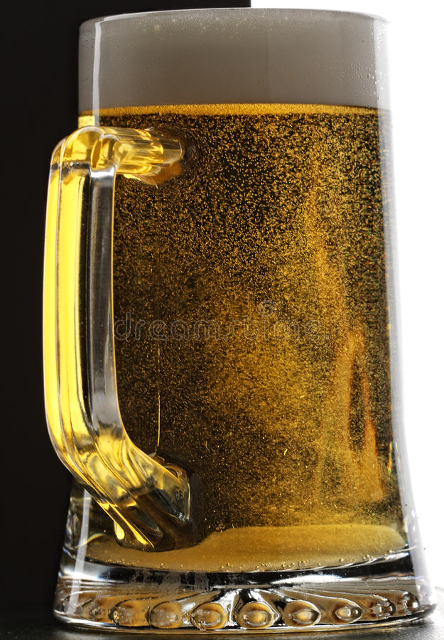 Mug of fresh beer royalty free stock photo
