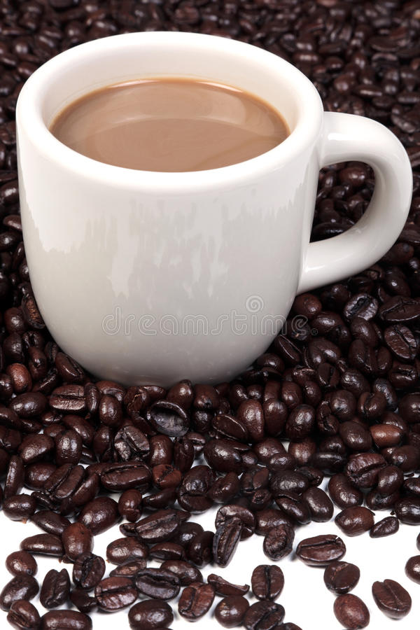Mug Full Of Hot Coffee And Beans Royalty Free Stock Photography