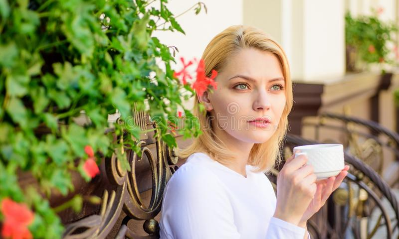 Mug of good coffee in morning gives me energy charge. Girl drink coffee every morning at same place as daily ritual. Woman have drink cafe terrace outdoors royalty free stock photos