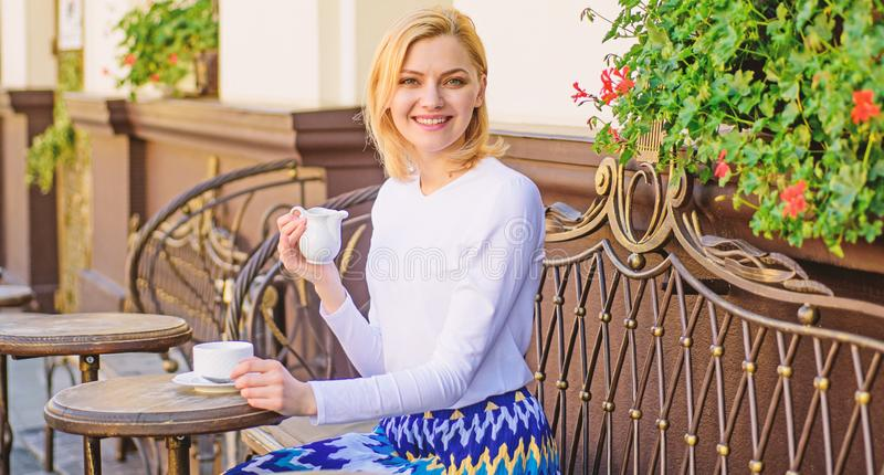 Mug of good coffee in morning gives me energy charge. Daily pleasant rituals make life better. Woman have drink cafe. Terrace outdoors. Girl drink coffee every royalty free stock image