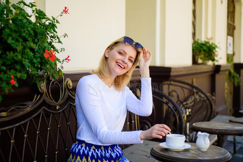 Mug of good coffee in morning gives me energy charge. Woman elegant happy face have coffee cafe terrace outdoors. Girl. Drink coffee every morning at same place stock images