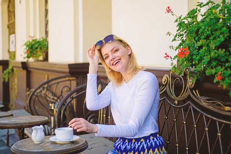 Mug of good coffee in morning gives me energy charge. Woman elegant happy face have coffee cafe terrace outdoors. Girl. Drink coffee every morning at same place royalty free stock photography