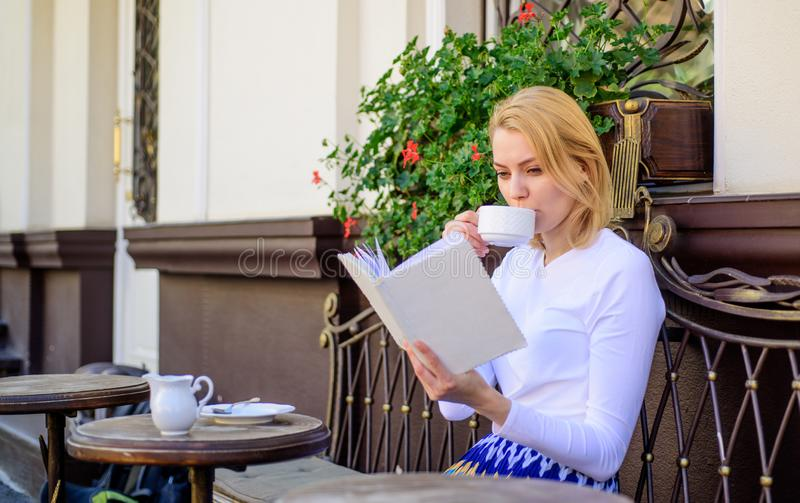Mug of good coffee and pleasant book best combination for perfect weekend. Girl drink coffee every morning at same place. Daily ritual. Bookworm leisure concept stock photos