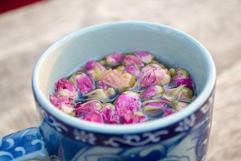 Mug of herbal tea stock photos