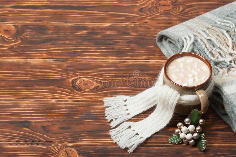 Mug Of Hot Chocolate Or Coffee With Marshmallows. Natural Wool Scarf. Wooden Background With Copy Space stock photos