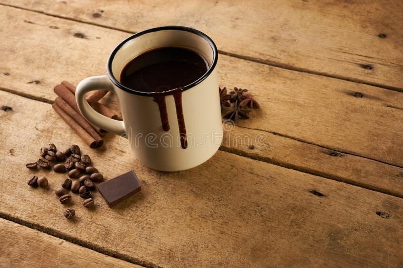 Mug of hot chocolate drink with cinnamon sticks coffee beans stock images