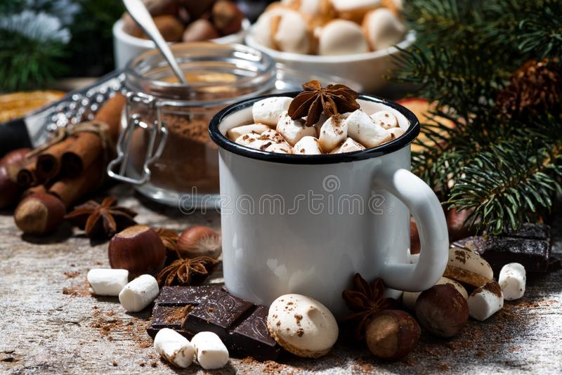 Mug of hot chocolate with marshmallows and sweets. On wooden table, closeup royalty free stock photography