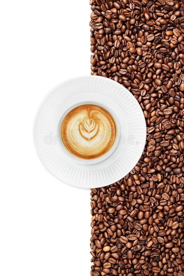 Mug of a Late on a white plate suraunded by coffee beans on the white background stock photos
