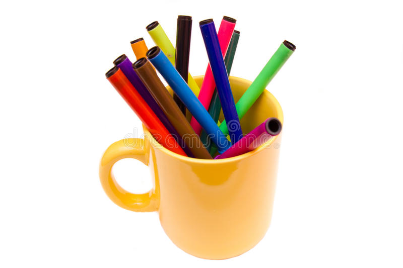 Mug with markers. Cup with markers on a white background stock image