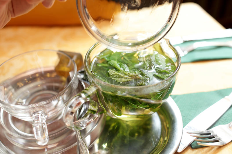 Mug of mint tea on a table. In the cafe stock photo