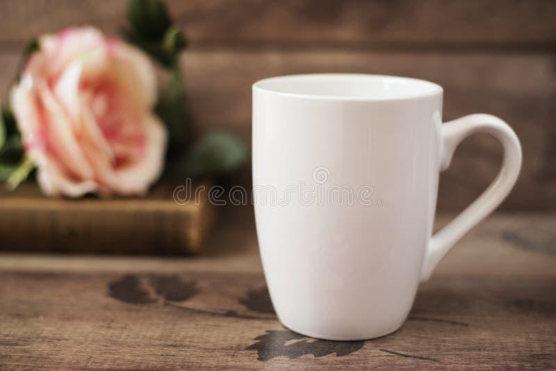 Mug Mockup. Coffee Cup Template. Coffee Mug Printing Design Template. White Mug Mockup, Old Book and Flower stock photo