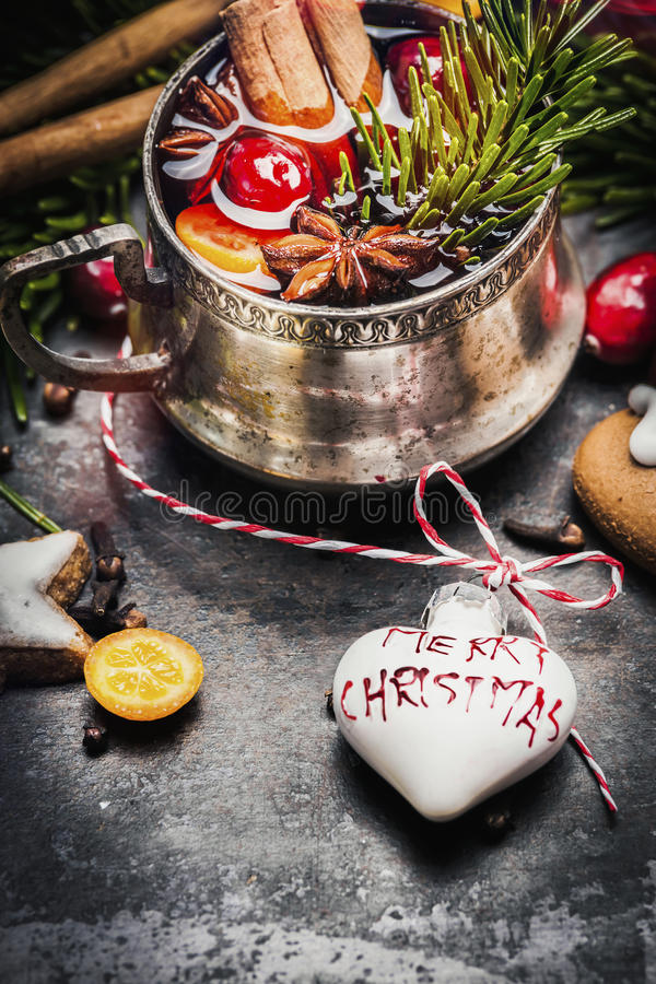 Mug of mulled wine with spices , cookies and Christmas decoration stock images