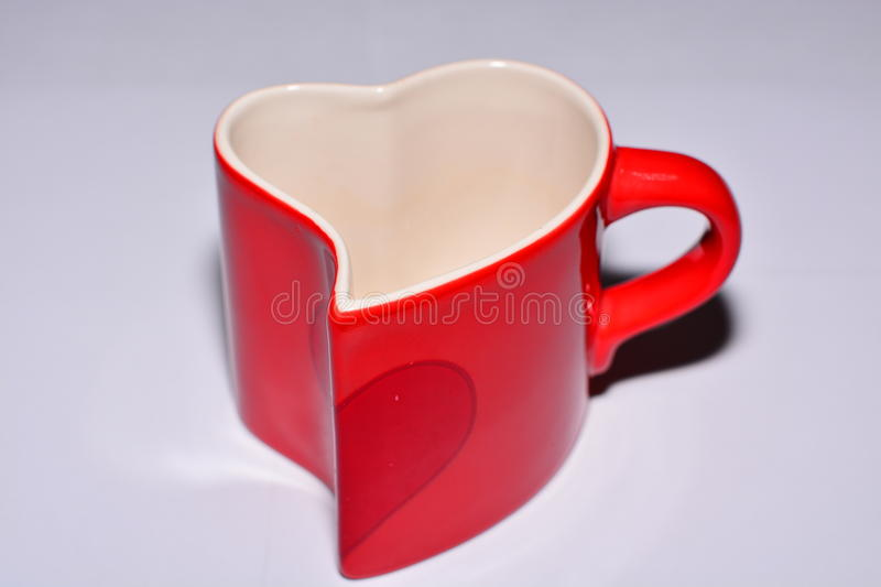 Mug in the shape of a heart stock images