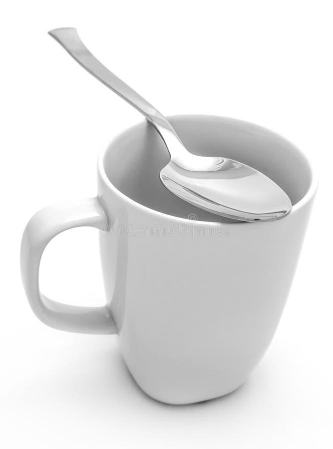 Mug and spoon stock photos