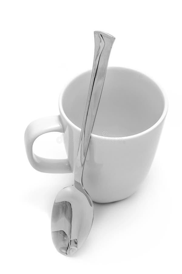 Mug and spoon royalty free stock image