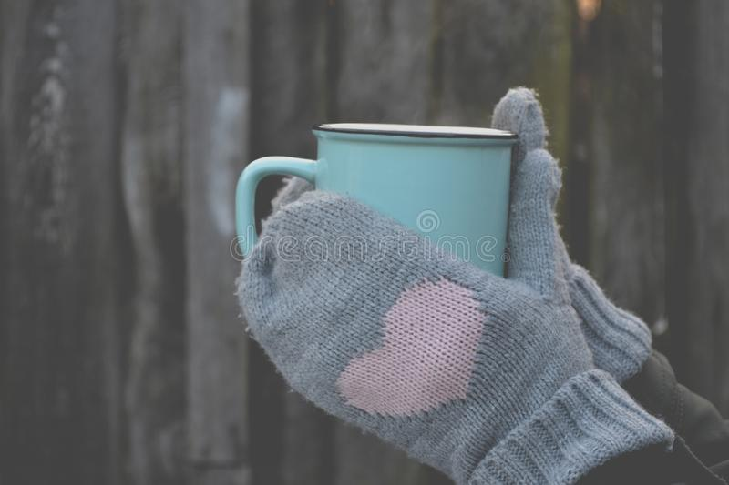 A mug of tea in cold weather. stock photos