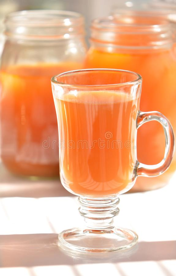Mug of vegetable bone broth. Homemade golden vegetable and chicken bone broth full of nutrition and health benefits.  Absolutely delicious stock photos