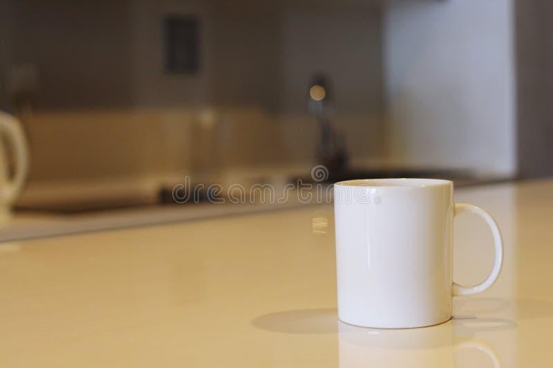 Mug on wooden table stock photo