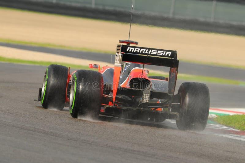 MUGELLO,意大利, 2012年:Marussia F1队的查尔斯・皮克赛跑在一级方程式赛车的合作测试天在Mugello电路在意大利 免版税库存图片