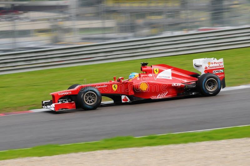 MUGELLO, ITALY 2012: Fernando Alonso of Ferrari F1 team racing at Formula One Teams Test Days at Mugello Circuit in Italy royalty free stock photography