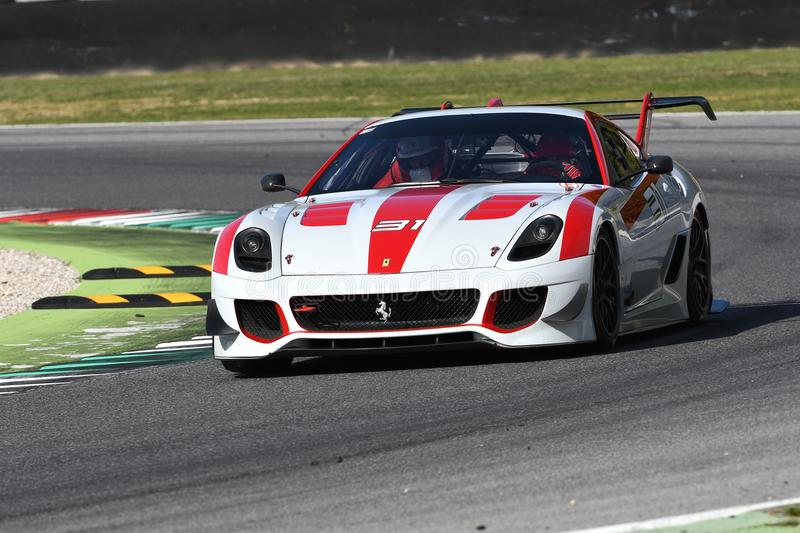 MUGELLO, ITALY - OCTOBER 2017: Unknown drives Ferrari 599XX during XX Programmes of Finali Mondiali Ferrari at Mugello Circuit stock image