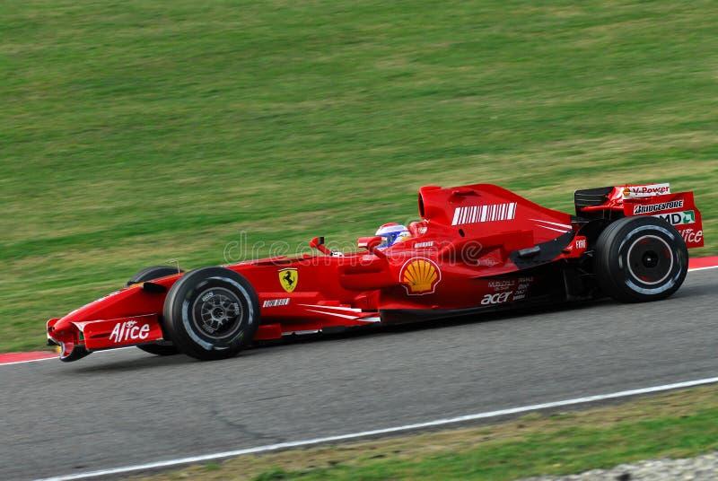 MUGELLO, IT, November, 2007: Officiële die Bestuurders Felipe Massa, Kimi Raikkonen, Luca Badoer en Marc Genè met Modern Ferrari royalty-vrije stock afbeeldingen