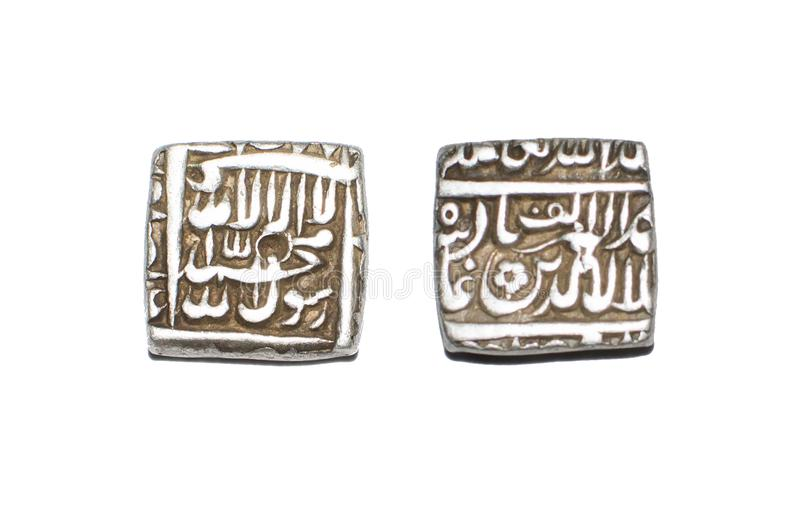 Silver Coin India Mughal Emperor Akbar. Mughal Emperor Akbar Silver Half Rupee Coin of India dated 1000 Hijri Year 1592 AD. Islami Kalima inscribed on obverse royalty free stock image