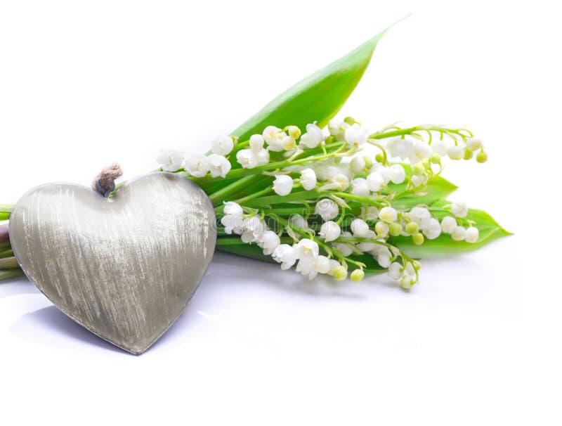 Mughetto e cuore, saluto di giorno del ` s della madre immagine stock
