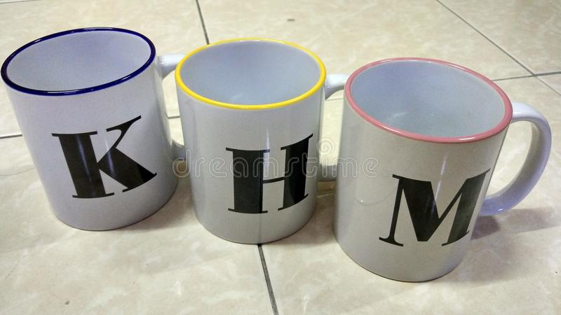 3 Mugs with alphabet royalty free stock photography